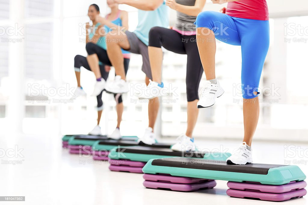 Group Of People Doing Step Aerobics In Gym royalty-free stock photo