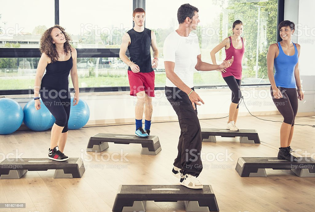 Group of people doing Step aerobics in the gym stock photo