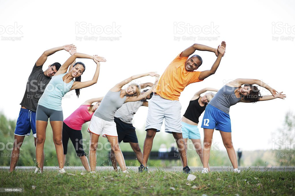 Group of people doing stretching exercises. royalty-free stock photo
