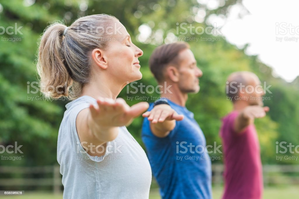 Group of people doing yoga stock photo