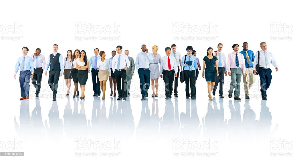 A group of people dressed professionally walking towards us stock photo