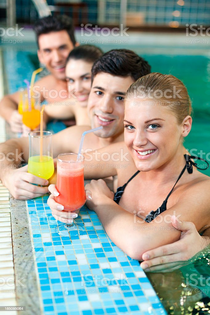 Group of people drinking juice in the pool royalty-free stock photo