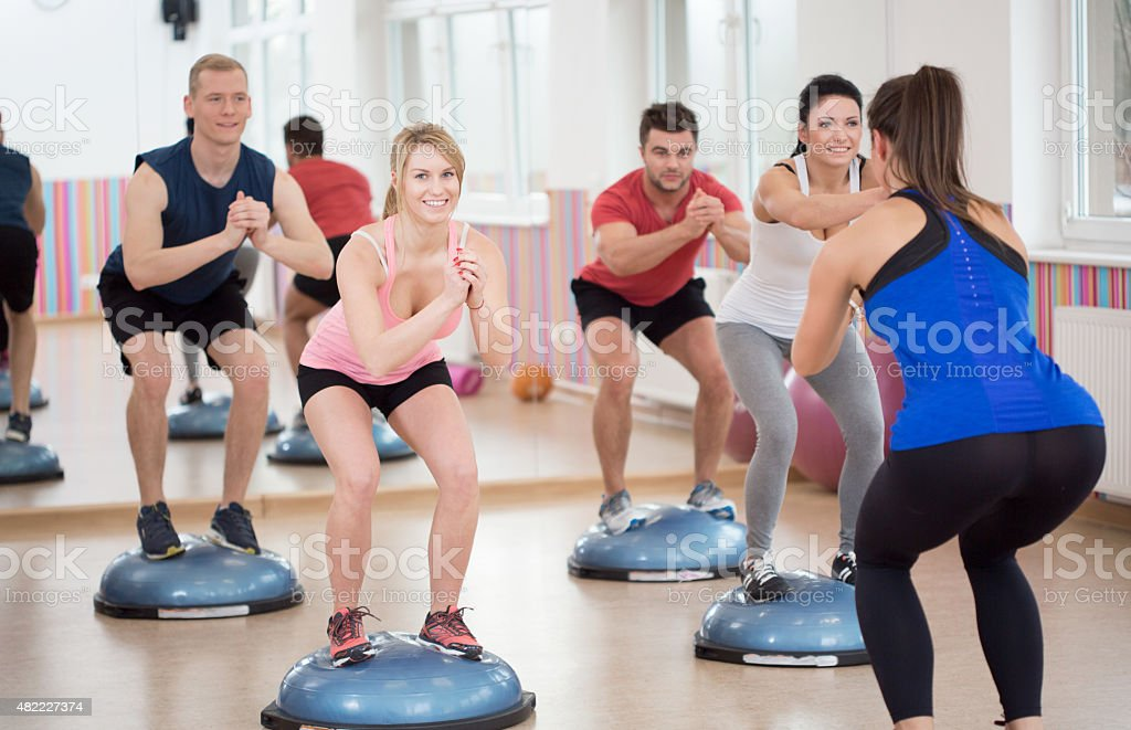 Group of people during balance training stock photo