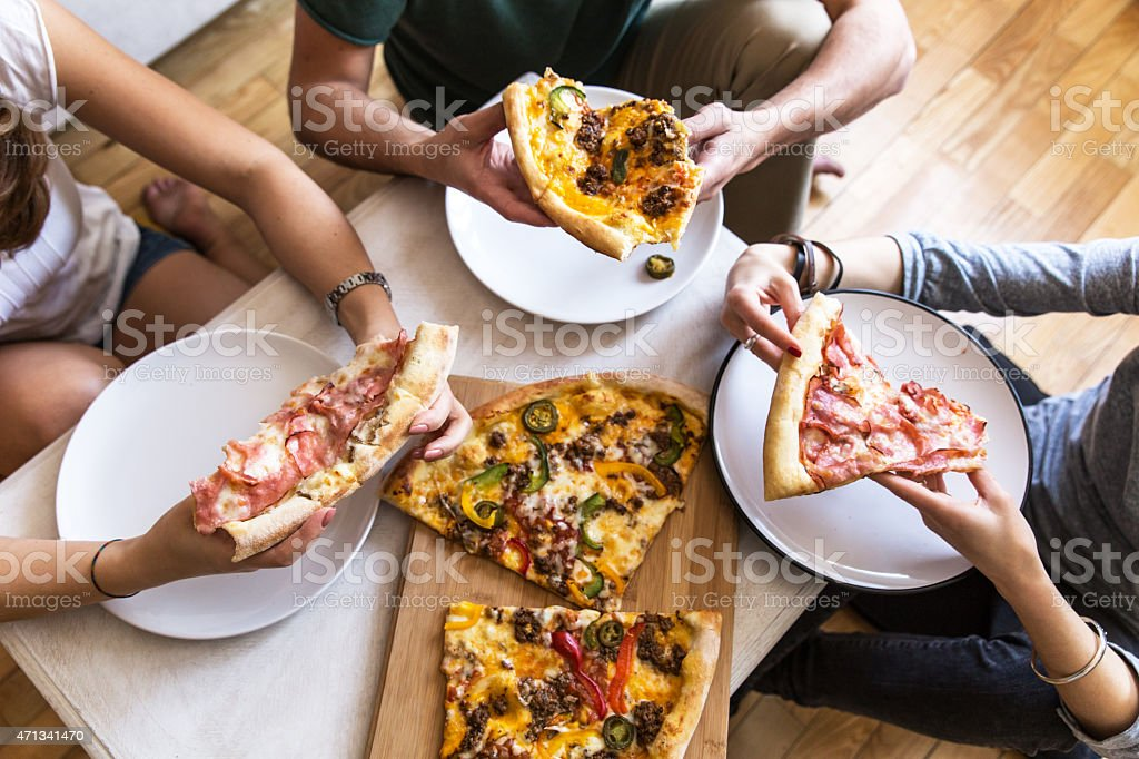 Group of people  eating pizza stock photo