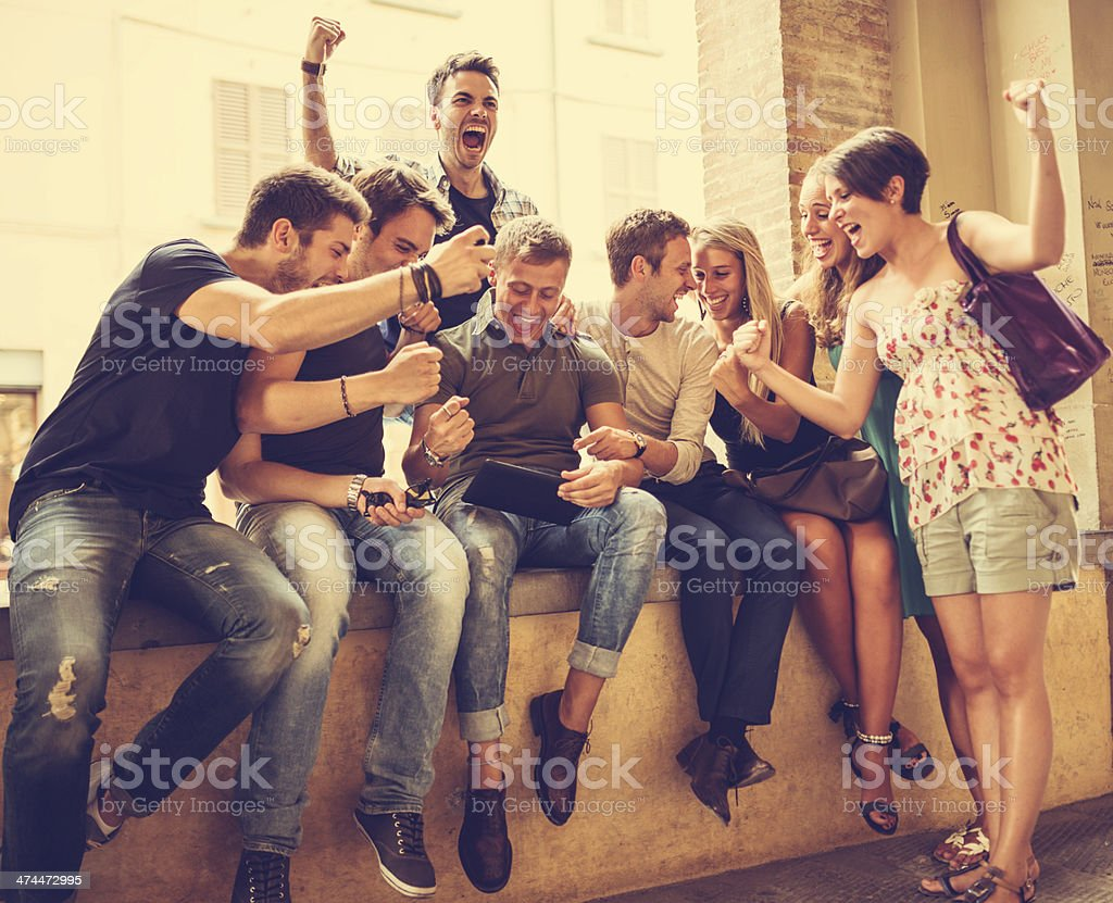 Group of people enjoying with a tablet stock photo