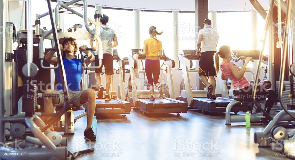 Group Of People Exercise in a gym. stock photo