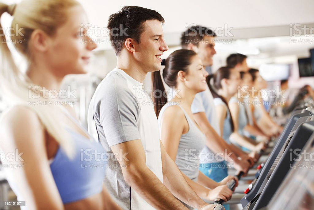 Group of people exercise on a running track in gym. royalty-free stock photo
