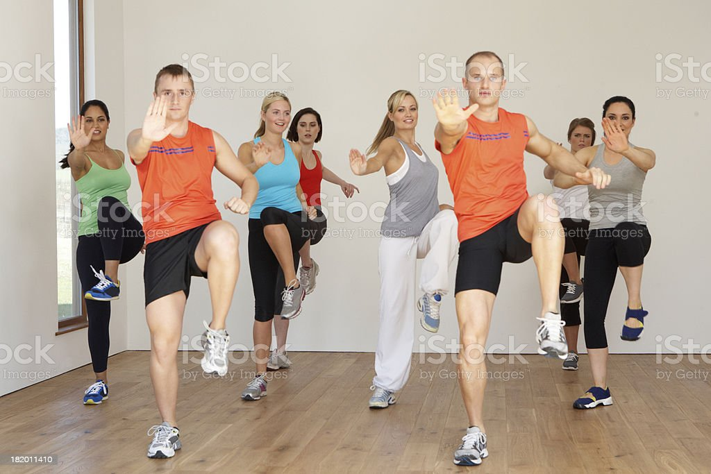 A group of people exercising in a dance studio stock photo