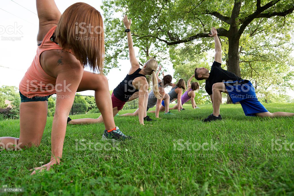 Group of People Exercising in the Park stock photo