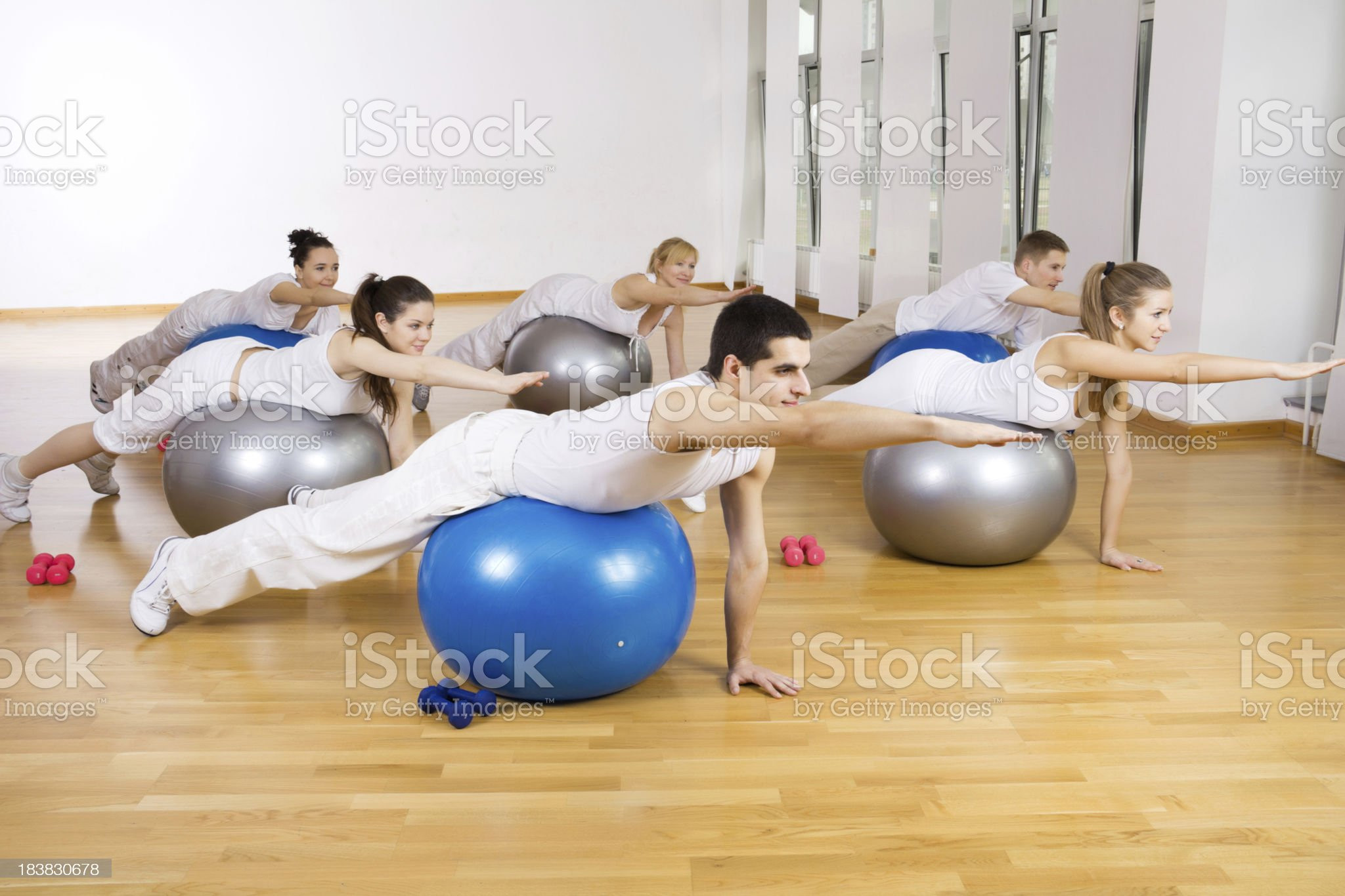 Group of people exercising on fitness balls. royalty-free stock photo