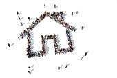 Group of people forming a house icon