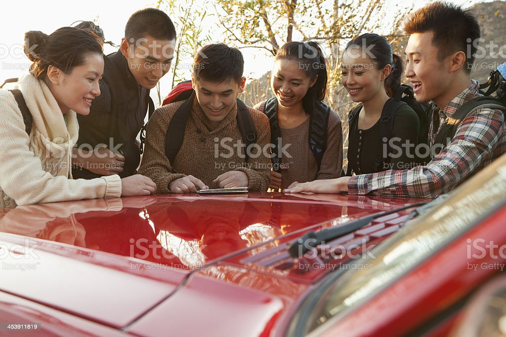 Group of people getting ready for hiking royalty-free stock photo