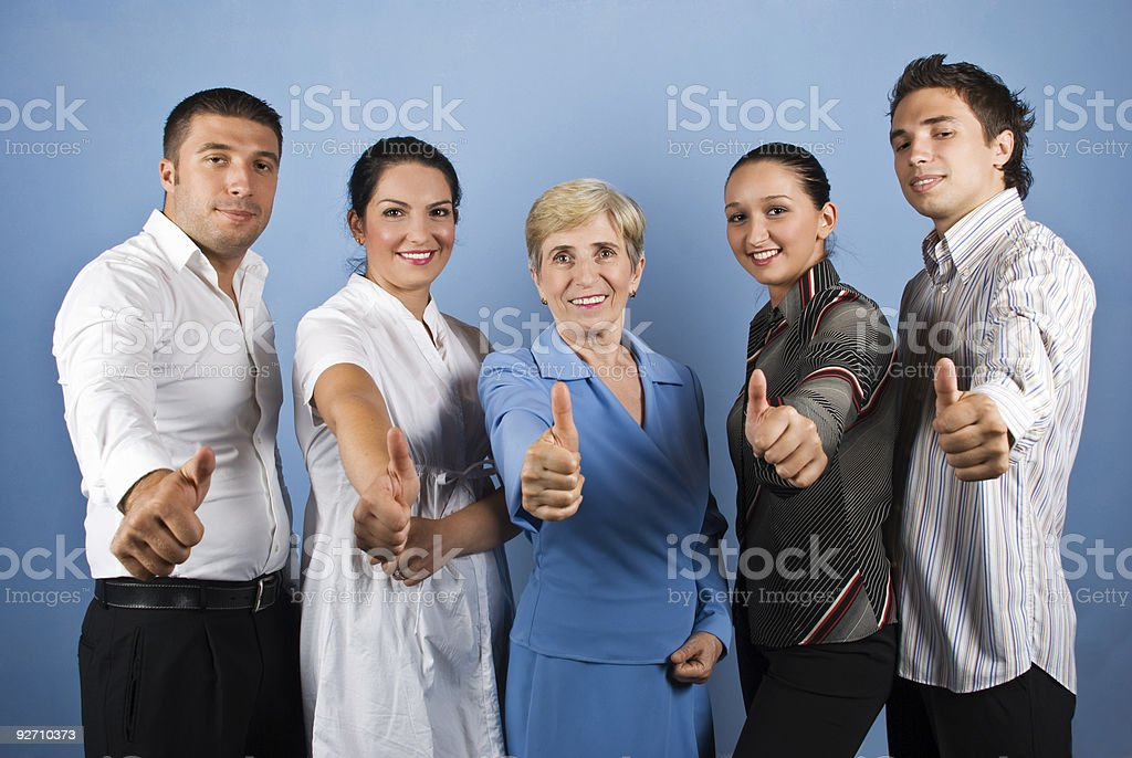 Group of people giving thumbs up royalty-free stock photo