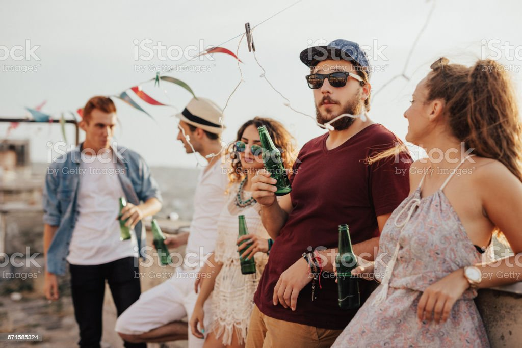 Group of people hanging out on the rooftop stock photo