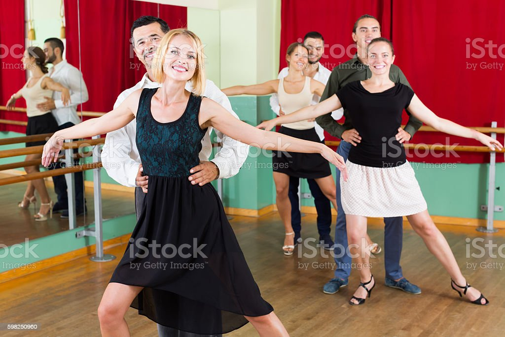 Group of people have fun while dancing waltz stock photo
