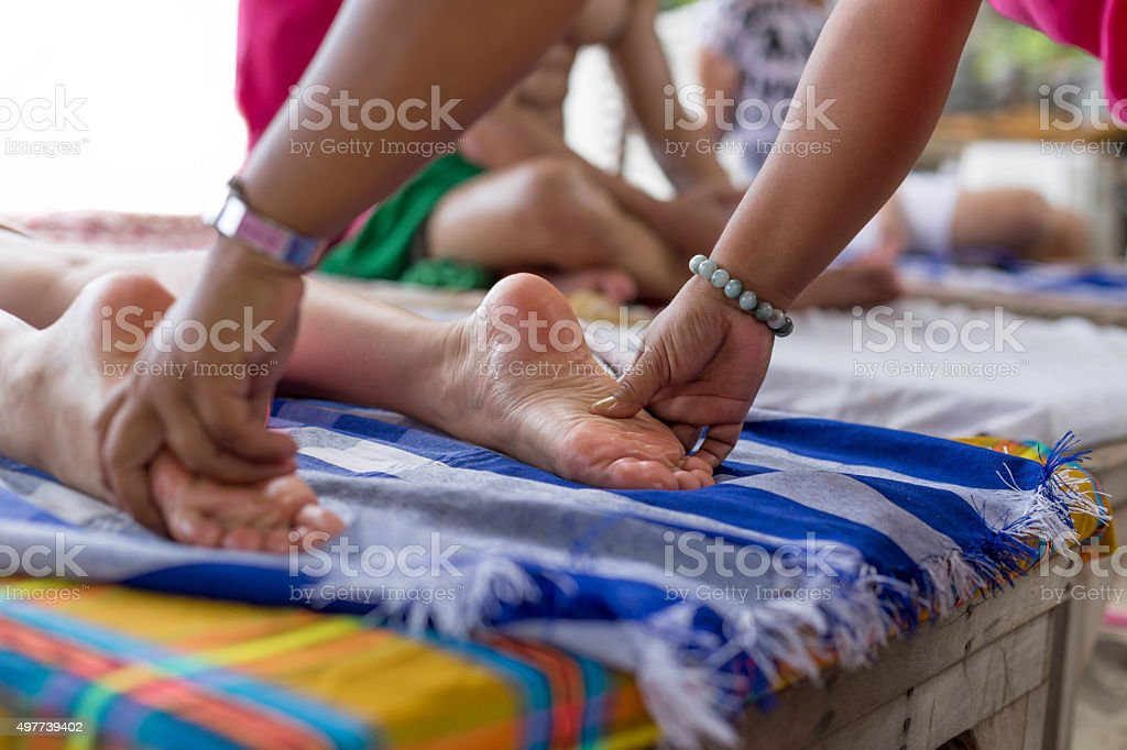 Group of people  having a masage on the beach stock photo