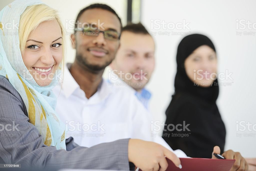 A group of people having a meeting in an office royalty-free stock photo