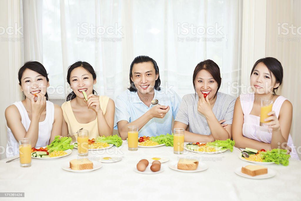 group of people having breakfast in the dining room royalty-free stock photo