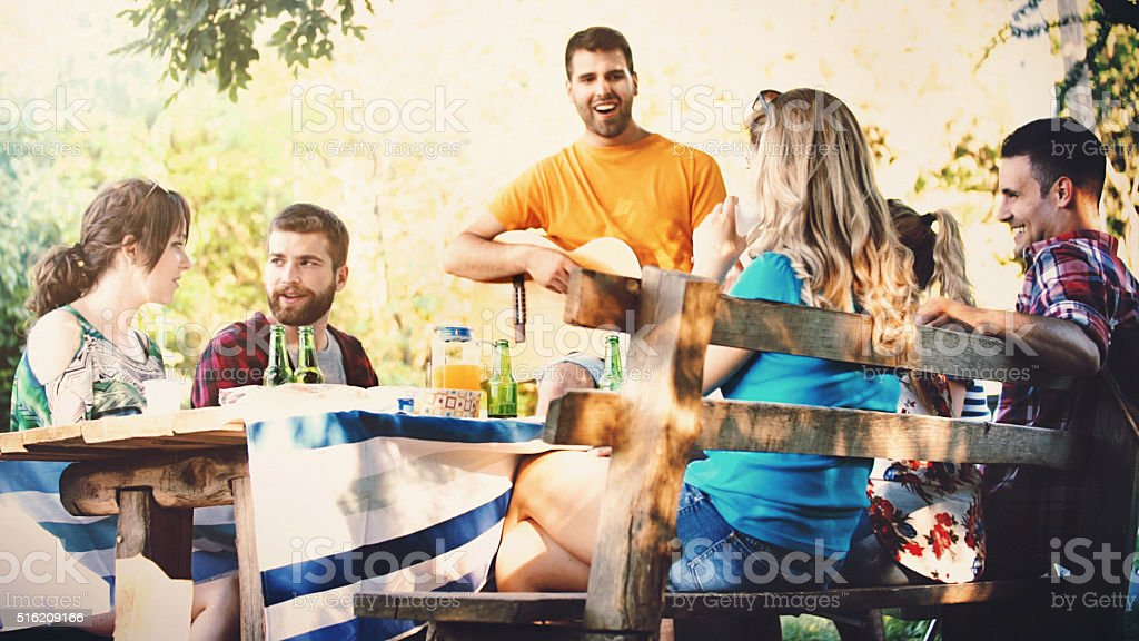 Group of people having picnic outdoors. stock photo