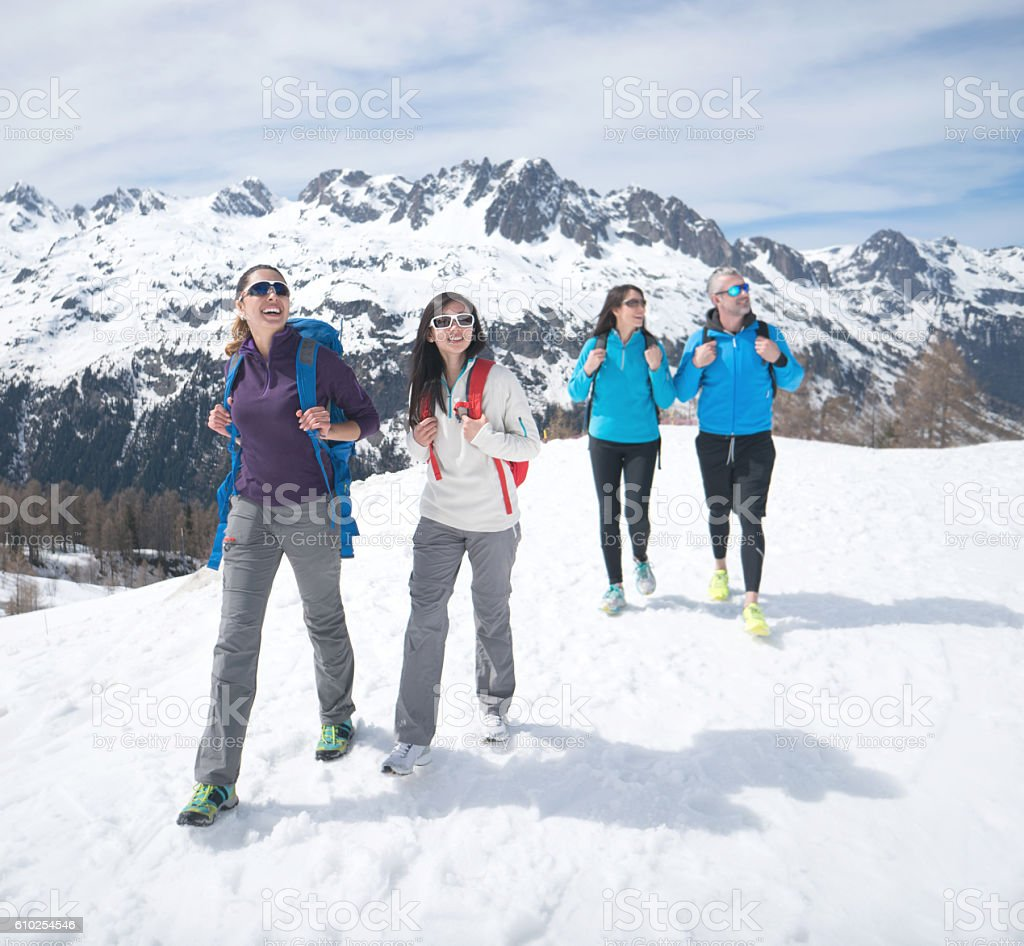 Group of people hiking in a snow mountain stock photo