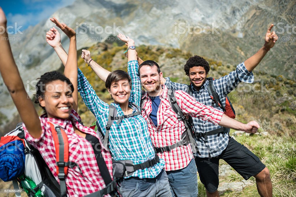 group of people hiking the mountain togetherness stock photo