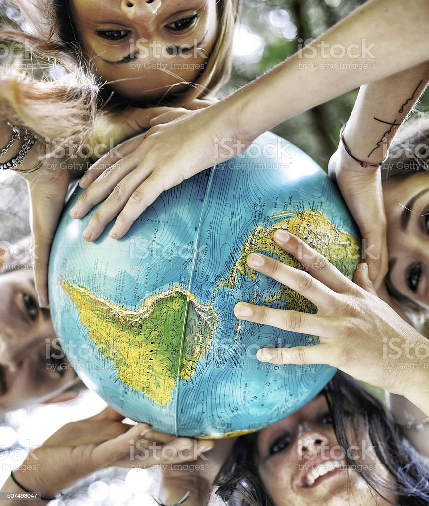Group of People Holding a Globe stock photo