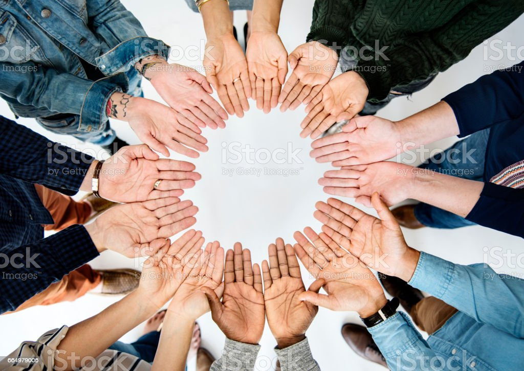 Group of people holding hand assemble together in aerial view stock photo