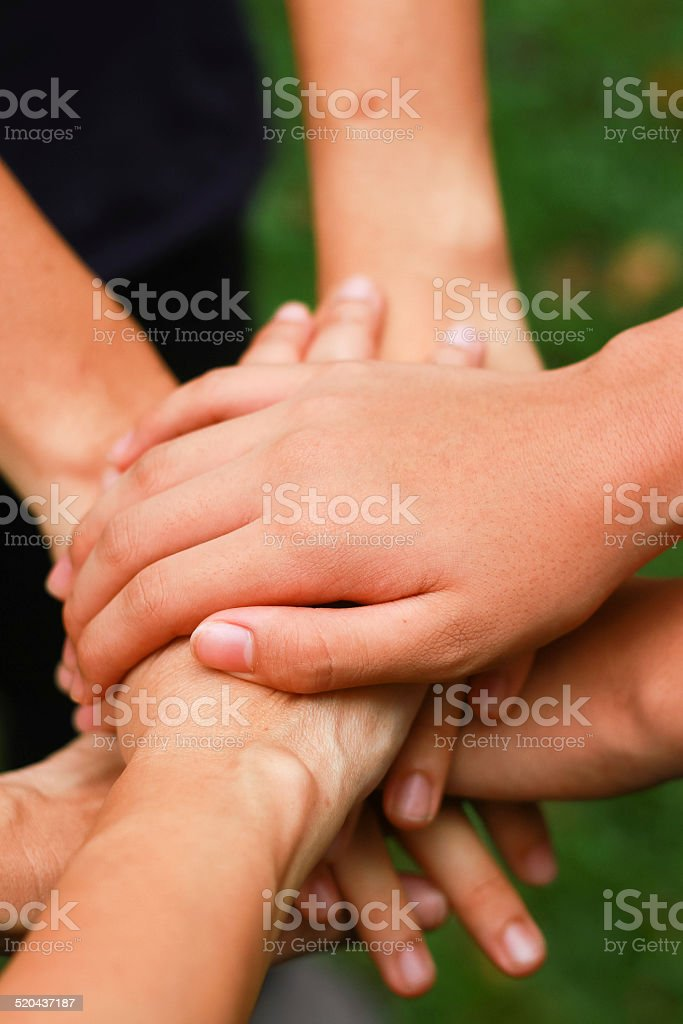 Group of people holding hand together stock photo