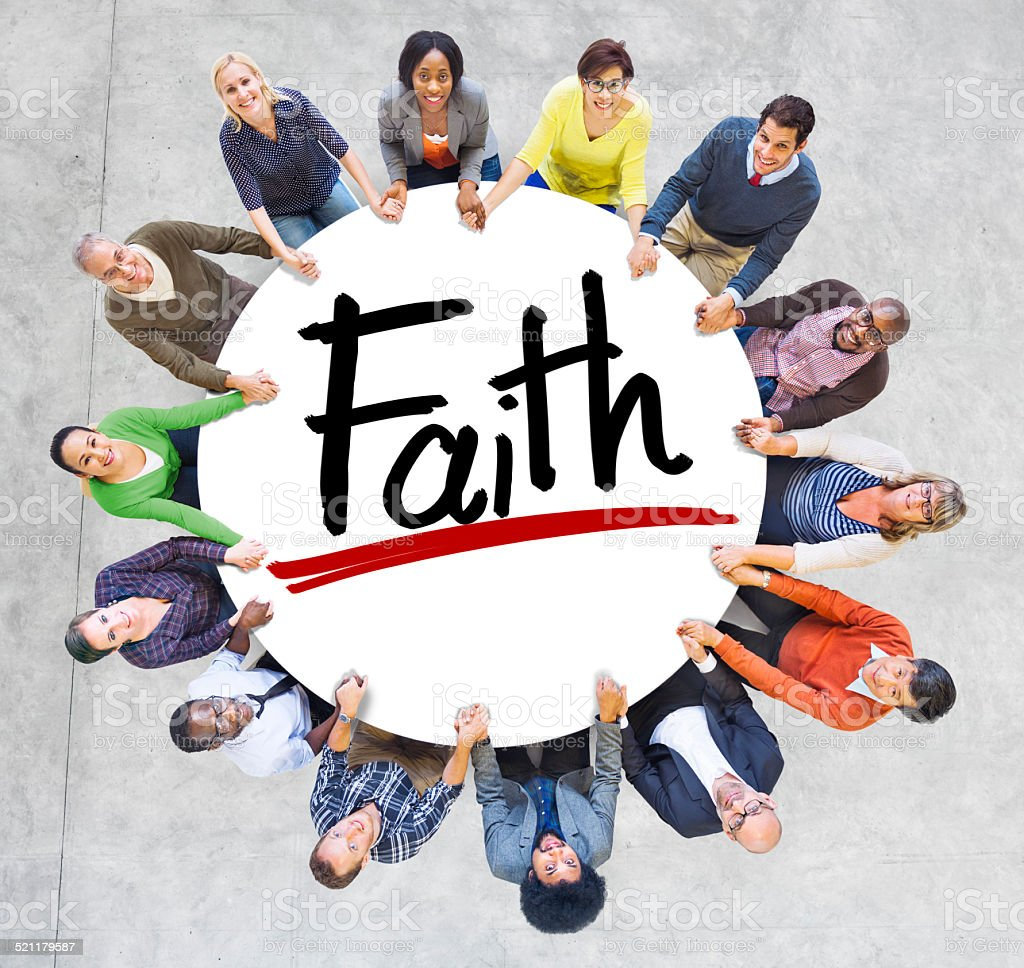Group of People Holding Hands Around the Word Faith stock photo