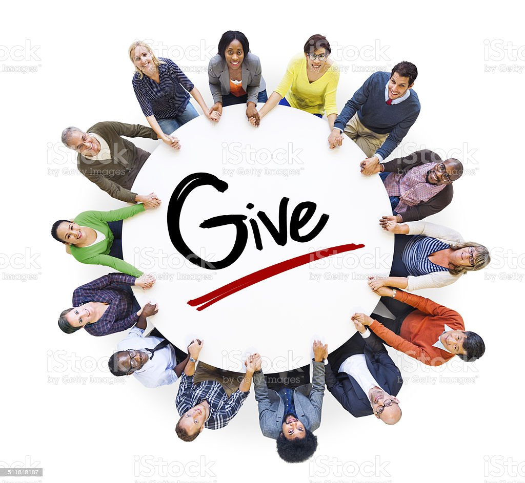 Group of People Holding Hands Around the Word Give stock photo