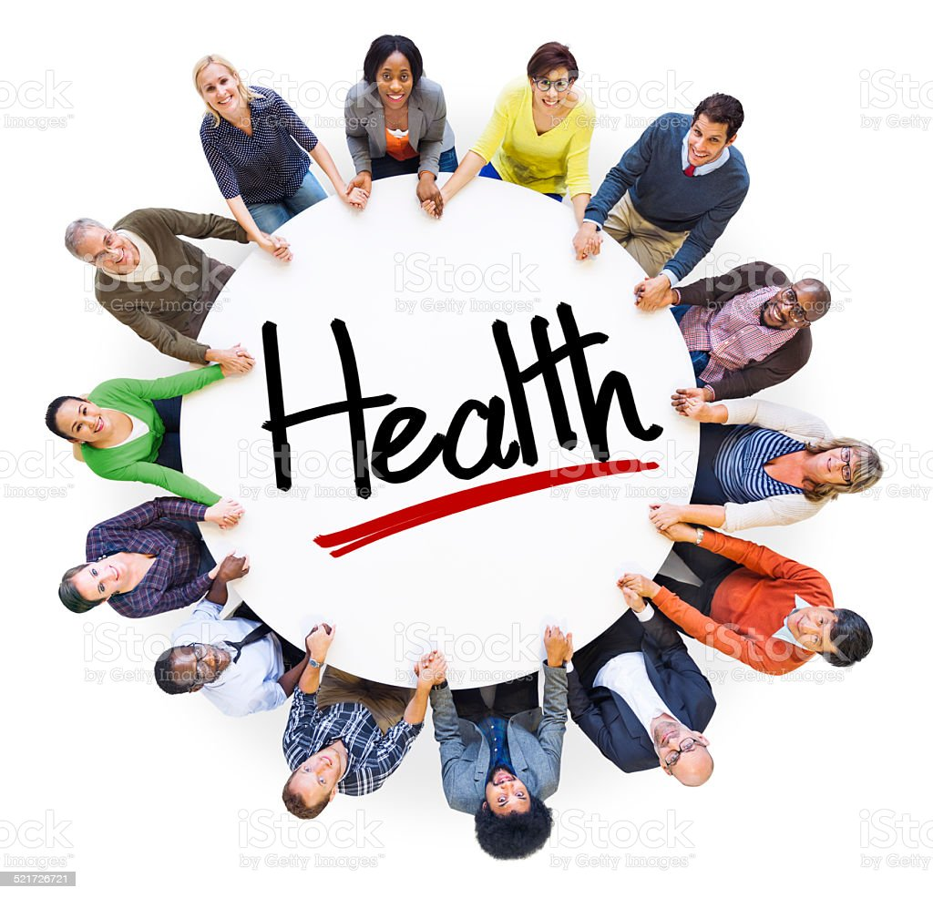 Group of People Holding Hands Around the Word Health stock photo