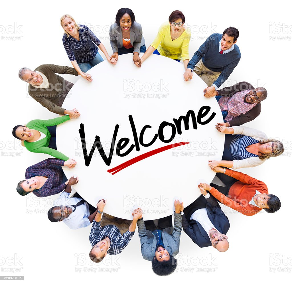 Group of People Holding Hands Around the Word Welcome stock photo
