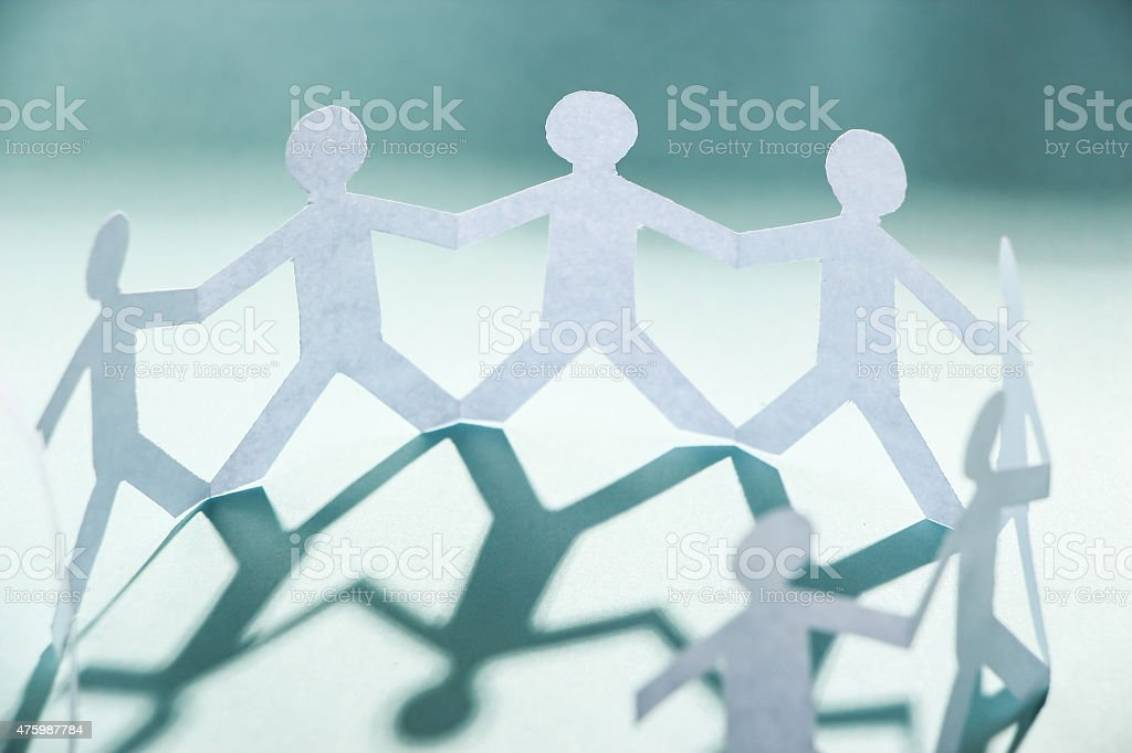 Group of people holding hands stock photo