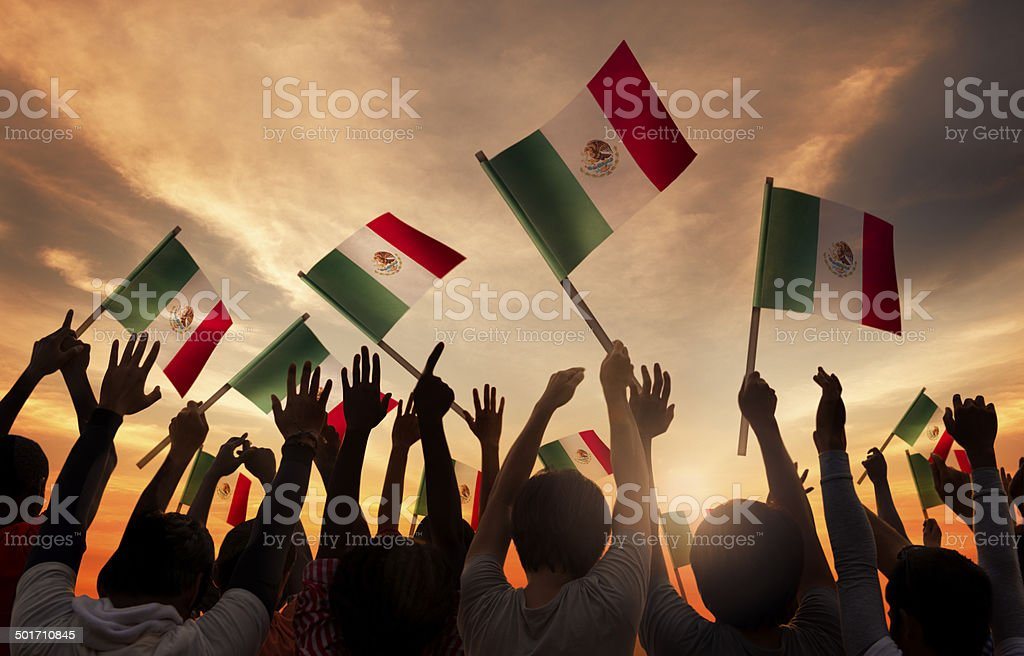 Group of People Holding National Flags of Mexico stock photo