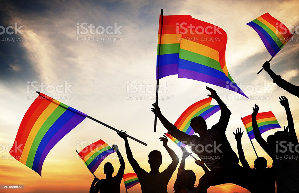 Group of People Holding Rainbow Flags stock photo