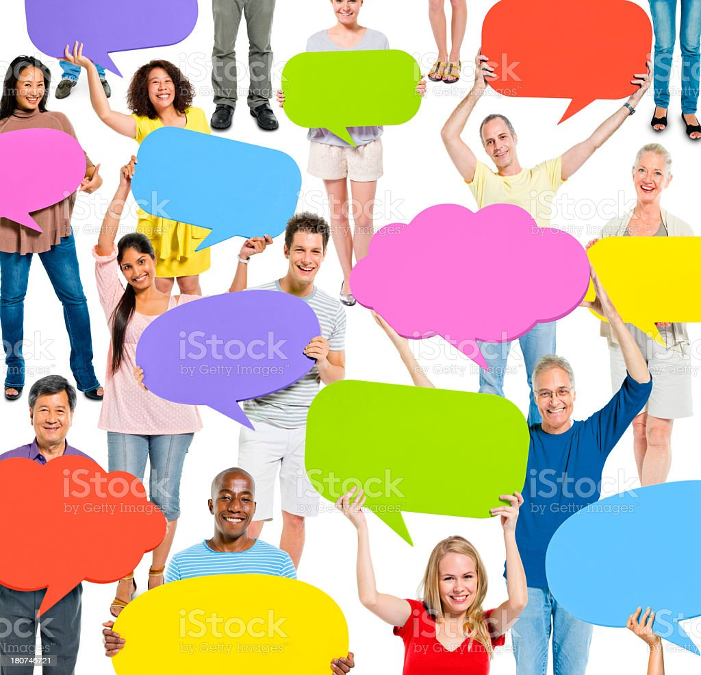 Group of people holding up colorful communication bubbles royalty-free stock photo
