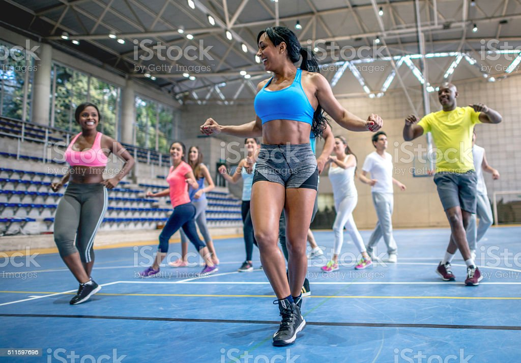 Group of people in a fitness class stock photo