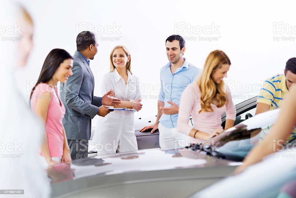 Group of people in a showroom. stock photo