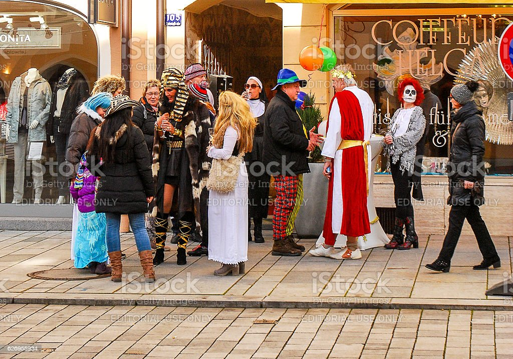 Group of people in carnival costumes talk stock photo