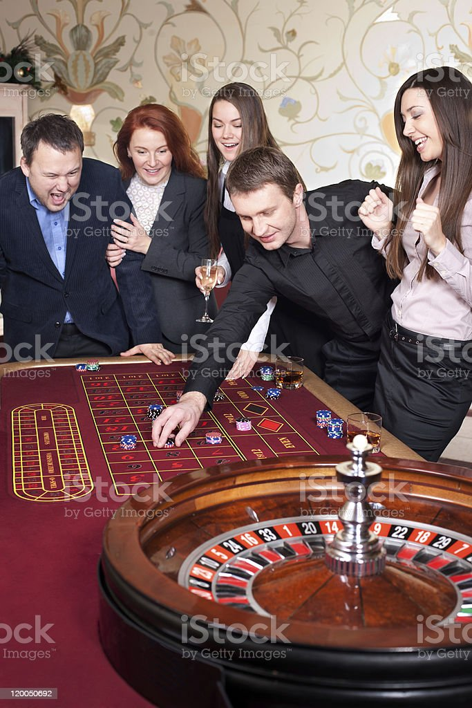 Group of people in casino royalty-free stock photo
