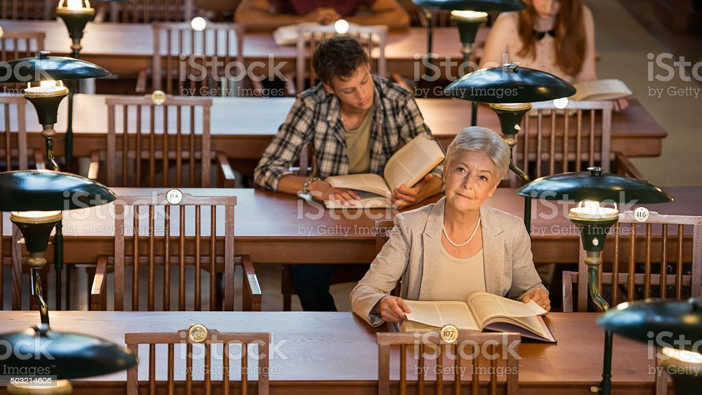 Group Of People In Library stock photo