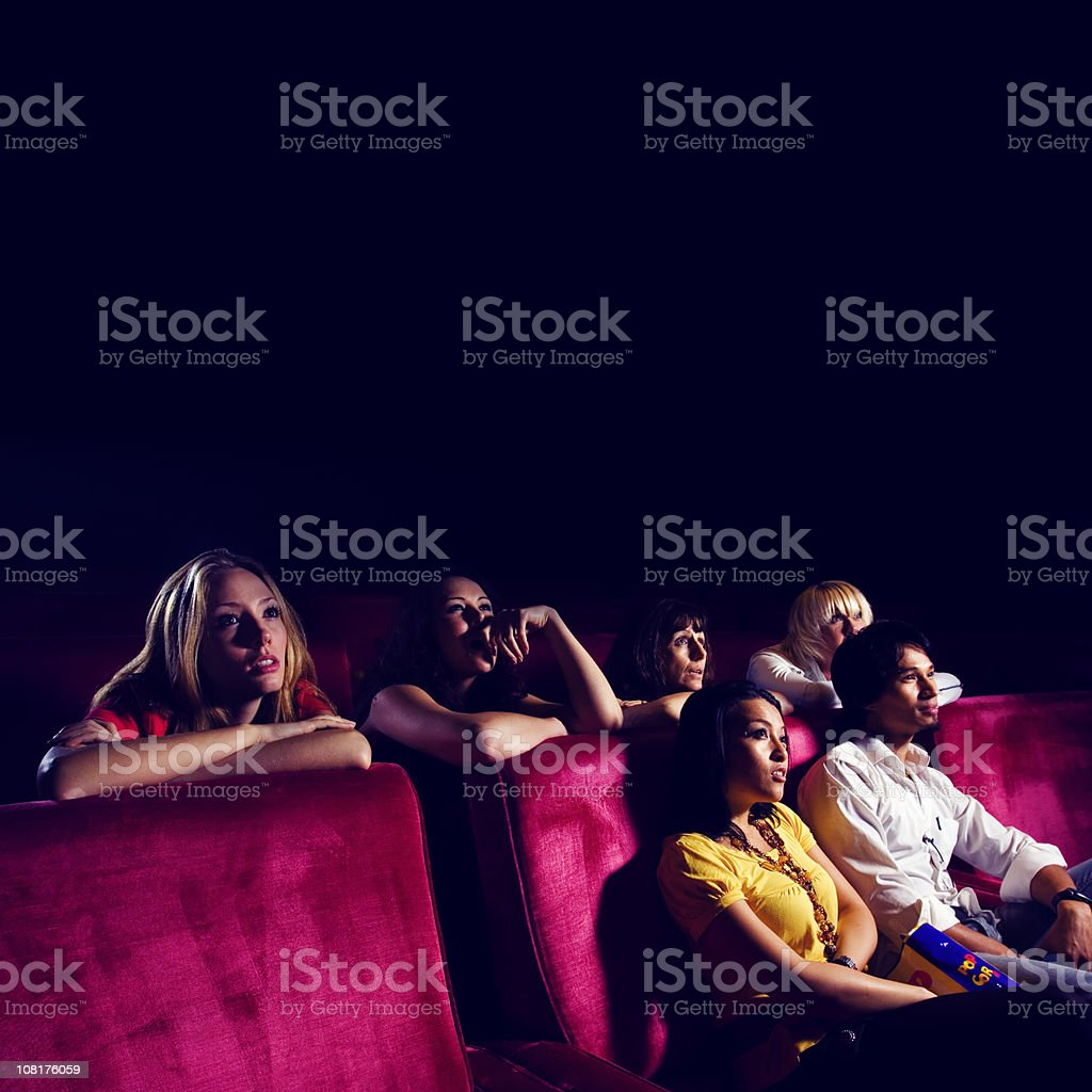 Group of People in Movie Theater stock photo