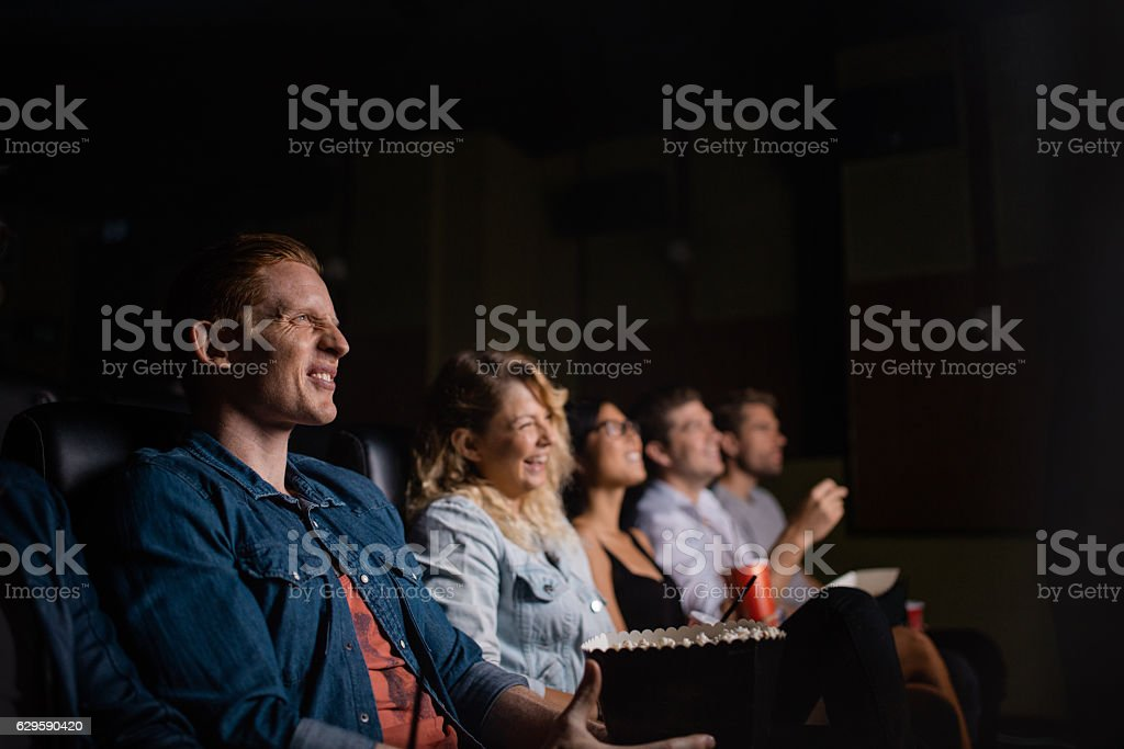 Group of people in multiplex movie theater stock photo