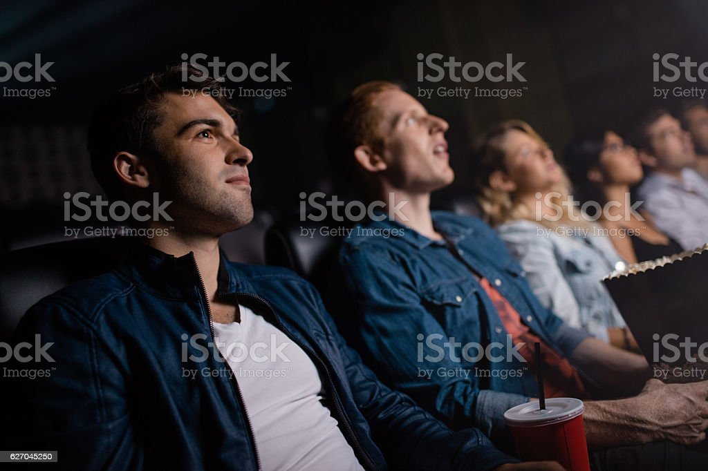 Group of people in multiplex theater stock photo