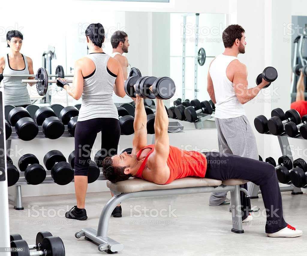 group of people in sport fitness gym weight training royalty-free stock photo