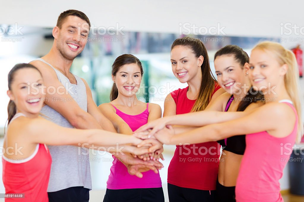 group of people in the gym celebrating victory stock photo