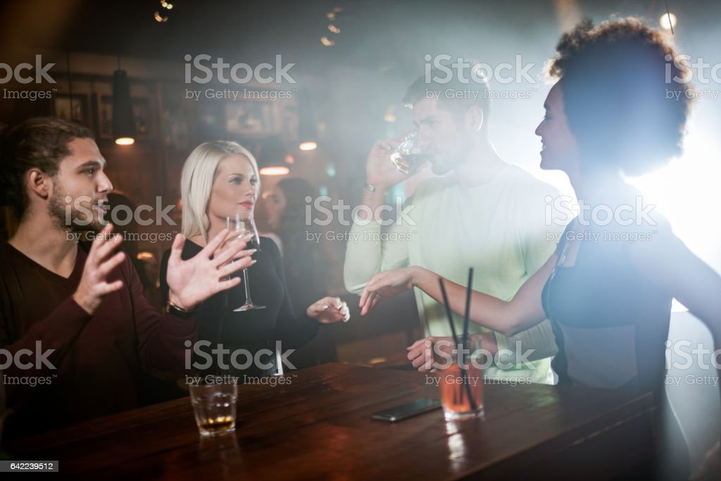 Group of people in the nightclub stock photo