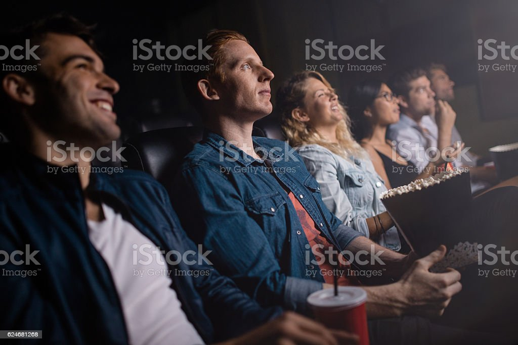 Group of people in theater watching movie stock photo