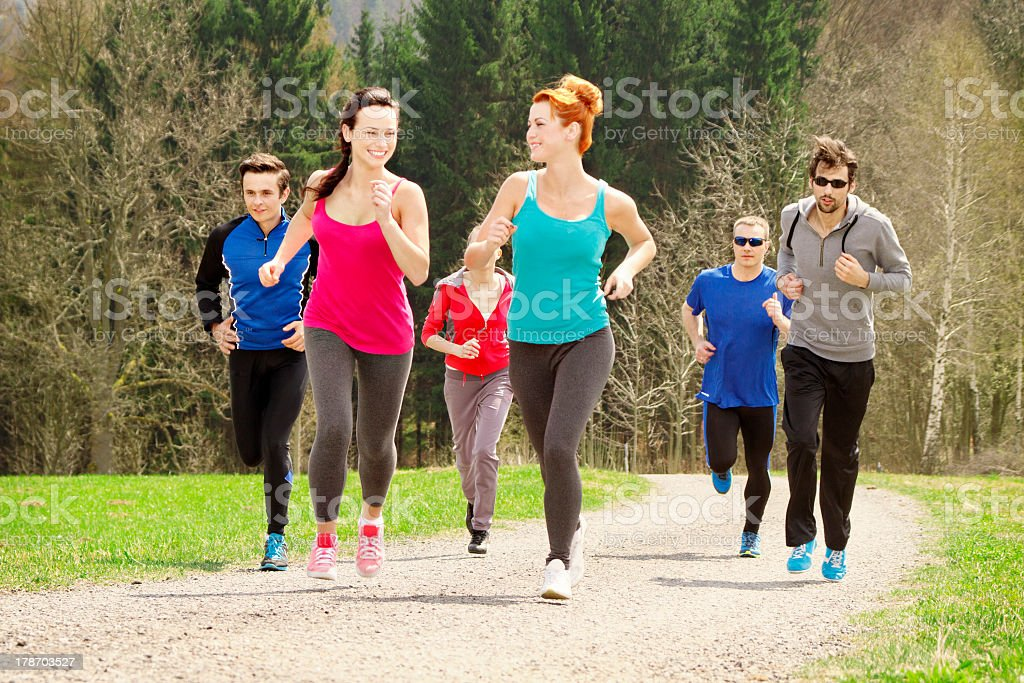 Group of people jogging in a park royalty-free stock photo