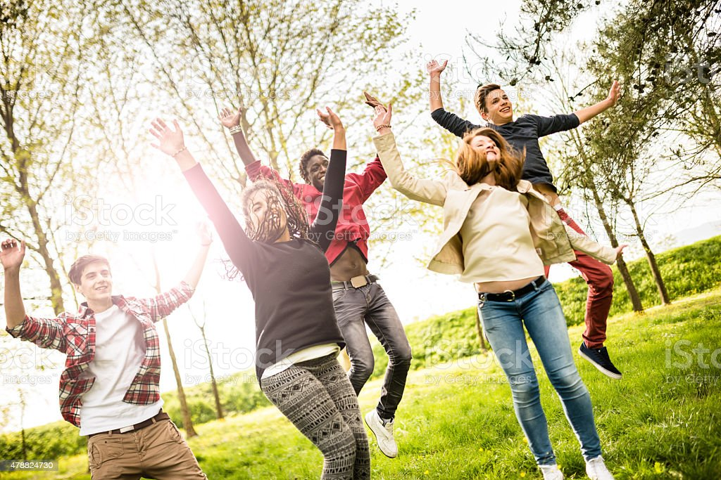Group of people jumping happiness stock photo